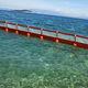 barrera de contención / flotante / permanente / para aguas tranquilas