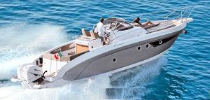 barco cabinado fueraborda / bimotor / open / con consola central