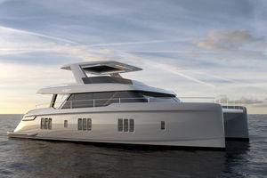 yate a motor catamarán a motor / de crucero / de gran velocidad / con fly