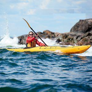 kayak cerrado / rígido / de surf / para expedición
