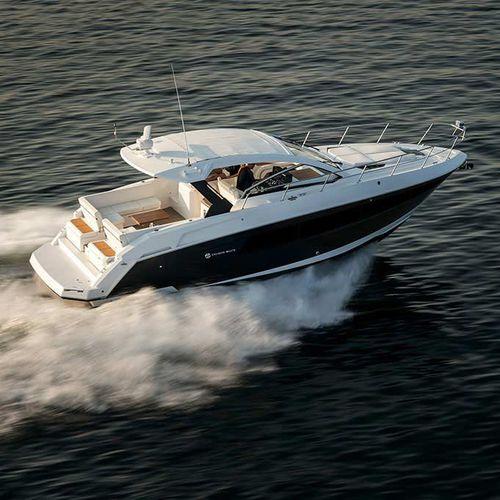 barco cabinado intraborda / diésel / soft-top / de crucero