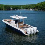 barco open fueraborda / trimotor / con consola central / open