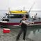 barco de pesca-crucero fueraborda